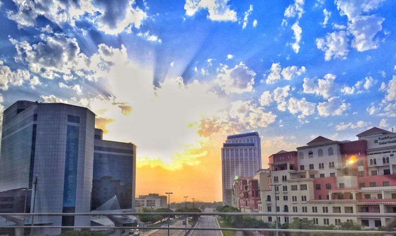 Sunrise Dubai❤ dubaicity Photography Morning sky Golden Amazing sun Creativity Brilliant Highlights Composition Layers Shot Amazing View Angle Capture IPhoneography Bright Clouds IPhone Photography Scenic Warmth Classic Layers And Colors looking Window iphone6 Sharp dubai healthcare city