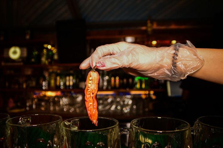 Cropped hand preparing drink