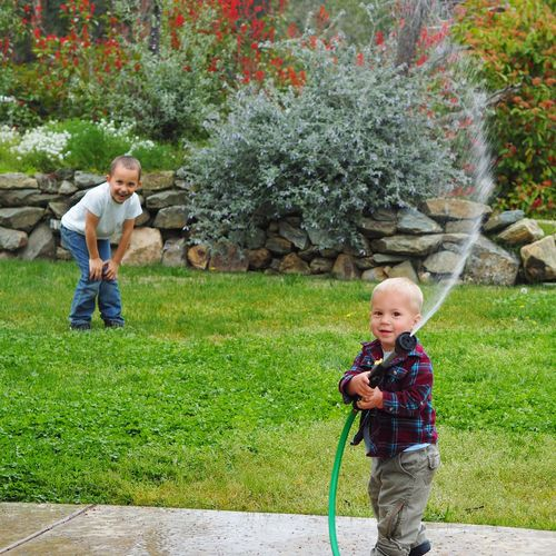 Child Males  Smiling Childhood Water Togetherness Happiness Boys Spraying Females Sprinkler Grandchild Garden Hose Hose