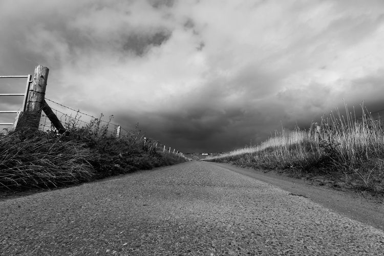 We all walk the long road Bayble Blackandwhite Photography Long Road Ahead Long Road Autumn Scotland Isle Of Lewis Scotlandsbeauty Sky Cloud - Sky The Way Forward Nature Direction Road No People Day Beauty In Nature Diminishing Perspective Plant Outdoors Architecture Land Environment Built Structure Scenics - Nature Overcast