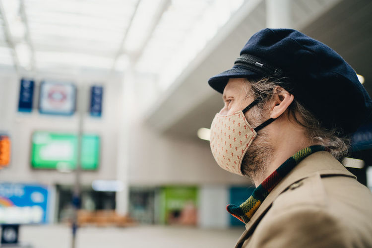 Portrait of man wearing hat and a face mask