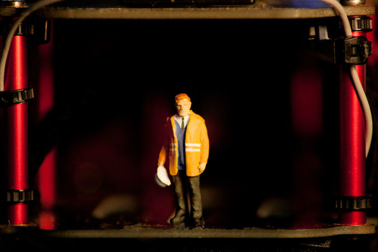Portrait of man standing in illuminated shop
