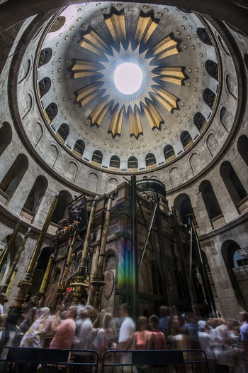 The Aedicula where, according to Christian religious tradition, the body of Jesus was buried. Church of the Holy Sepulchre - Jerusalem Aedicula Architecture Building Exterior Built Structure Christian Louboutin Church Crowd Cultures Day Dome Holy Indoors  Jerusalem Jesus Christ Jesus Loves You Large Group Of People People Real People Sepulchre Sky Tourism Travel Travel Destinations Women