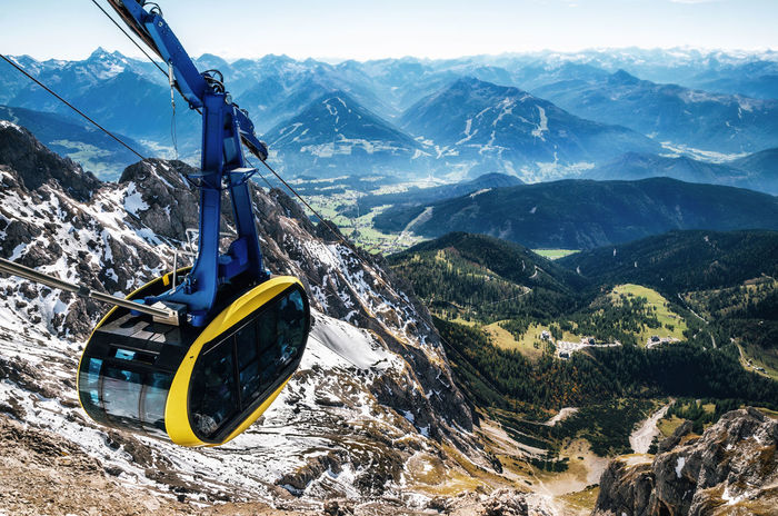 Cable car or gondola to mountain peak of Dachstein glacier in Austrian Alps Alpine Austria Dachstein Gondola Adventure Alps Alps Austria Beauty In Nature Landscape Mountain Mountain Range Movement Outdoors Overhead Cable Car Scenics Sky Transportation Go Higher
