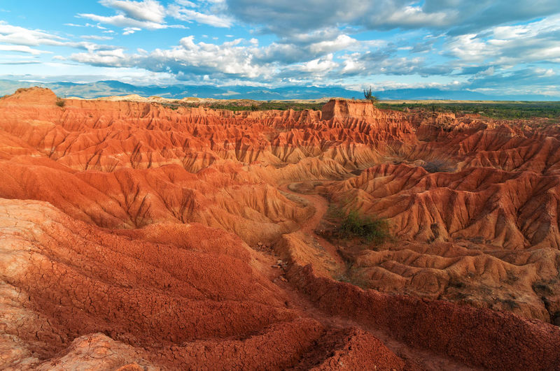 Scenic view of rock formations against cloudy sky at tatacoa desert