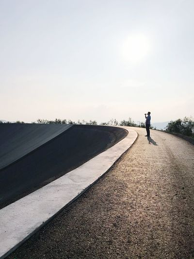 Bier Beer Sky One Person Real People Lifestyles Road Nature Sunlight Clear Sky Outdoors The Way Forward Direction Marking Transportation Road Marking Leisure Activity Symbol Full Length Day Men Copy Space