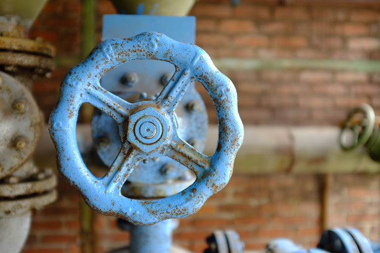 Metal Valve Focus On Foreground Brick Wall Close-up Brick Rusty Day No People Machine Valve Wall Old Machinery Art And Craft Shape Wall - Building Feature Technology Outdoors Pattern Architecture Wheel Silver Colored