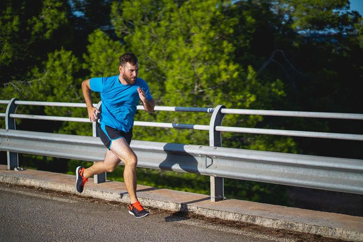 Full length of man running on railing