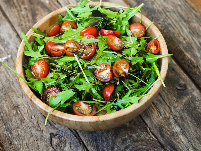 Arugula Close-up Day Food Food And Drink Freshness Green Color Healthy Eating Herb Lettuce No People Outdoors Ready-to-eat Salad Salad Bowl Tomato Tomatoes Vegetable Wood - Material