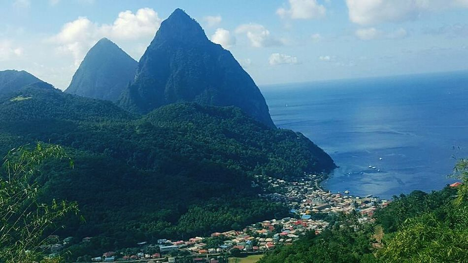 This was taken on the beautiful caribbean island of St.Lucia. Skyporn Sky And Clouds Skyviewers Ocean Ocean View Mountains Mountain Mountain View Green Color Town Town View Nature Nature Photography Natureporn Taking Photos Taking Pictures Awesomeness Shoreline Shore Tropical Climate Tropical Paradise Tropical Island Tropical Beauty . Eeyem Photography From My Point Of View