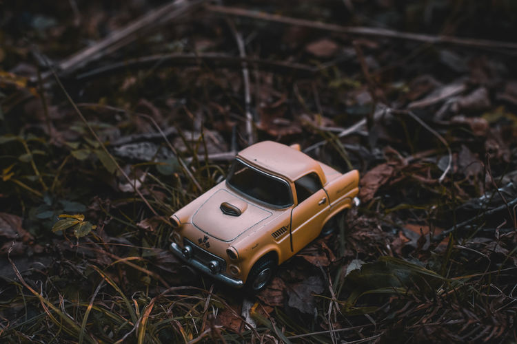 EyeEm Japan ASIA Shootermag AMPt_community Thedarksquare Toy No People Field Land Toy Car Nature Day High Angle View Plant Close-up Selective Focus Technology Focus On Foreground Outdoors Single Object Abandoned Still Life Car Mode Of Transportation