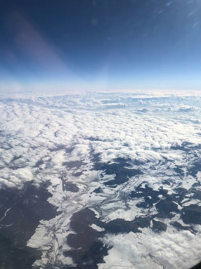 Aerial view of landscape against sky during winter