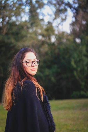 Gothic Beautiful Woman Day Eyeglasses  Focus On Foreground Forest Happiness Leisure Activity Lifestyles Long Hair Looking At Camera Nature One Person Outdoors People Portrait Real People Smiling Standing Tree Vampire Young Adult Young Women