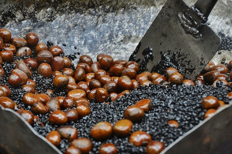 Close-Up Of Roasted Nuts In Container