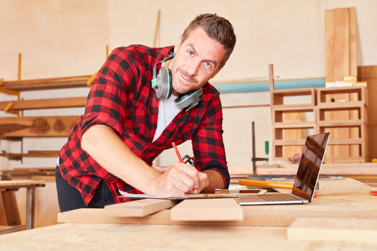 Portrait of man working on table