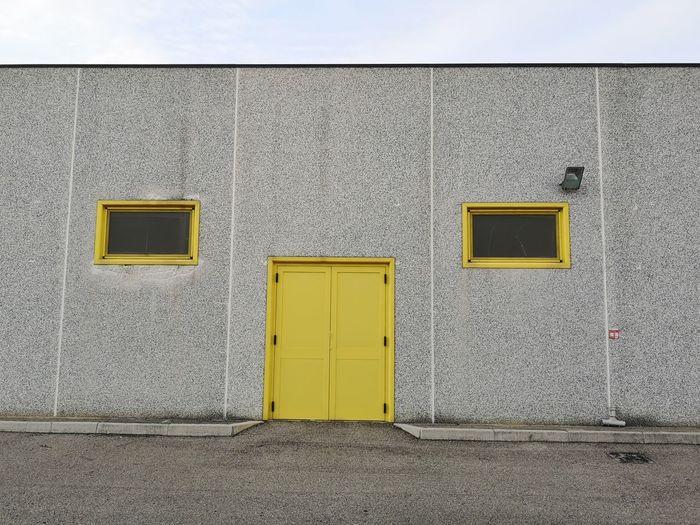 Yellow closed door of building