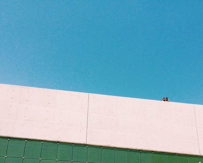 Man against clear blue sky