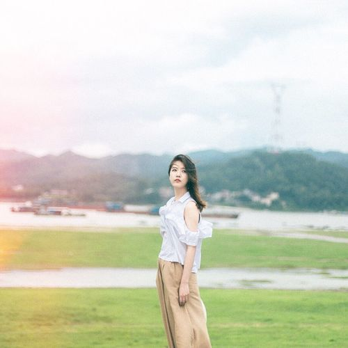 Mountain One Person Young Adult Nature Lifestyles Leisure Activity Outdoors Mountain Range Casual Clothing Real People Beauty In Nature Sky Women Landscape Young Women Beautiful Woman Beauty Day Grass Beautiful People