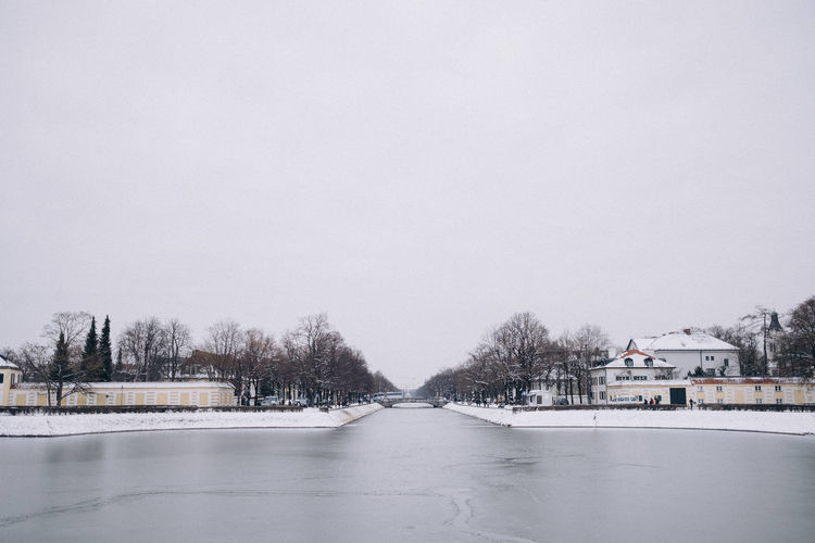 Frozen Nymphenburg Canal on a winter day. Munich, Bavaria, Germany. Bavaria Munich Nymphenburg Palace Winter Architecture Bare Tree Beauty In Nature Building Exterior Built Structure Clear Sky Cold Temperature Copy Space Day Europe Frozen Germany Nature No People Nymphenburg Castle Outdoors Scenics Sky Snow Tranquility Tree Water Weather Winter
