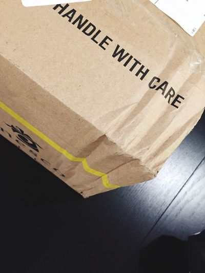 "Damaged ""Handle with Care"" package. Cardboard Box Box - Container Cardboard Text Handle With Care Package Parcel Mail Damaged Crushed Corner Cardboard Box Box"