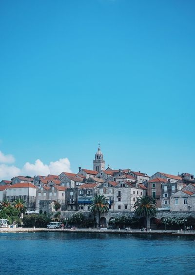 Architecture Blue Building Built Structure City City Life Cloud Croatia Day Korčula Nature No People Outdoors Residential Building Residential District Residential Structure Rippled Scenics Sky Town Tranquil Scene Tranquility Travel Destinations Water Waterfront