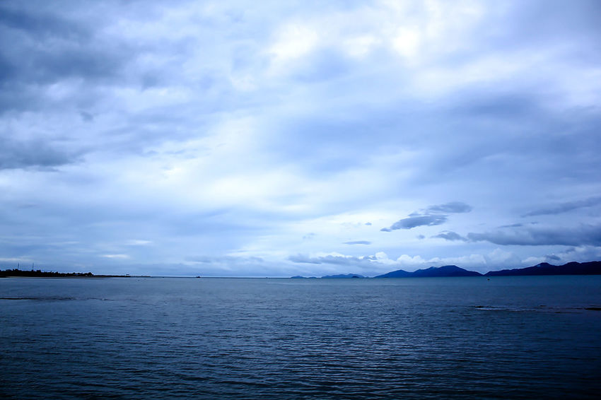 The sky is overcast. Beauty In Nature Blue Cloud - Sky Day Idyllic Landscape Sea Mountain Nature Nimbus Nimbus Cloud Nimbus Clouds No People Outdoors Overcast. Scenics - Nature Sea Sea And Sky Seascape Sky Sky Is Overcast. Tranquil Scene Tranquility View Into Land Water Waterfront