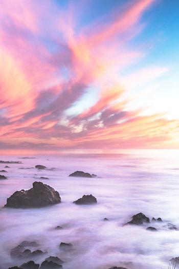Beach Beauty In Nature Cloud - Sky Dramatic Sky Horizon Over Water Landscape No People Outdoors Rock - Object Romantic Sky Scenics Sea Sky Sunset Tranquil Scene