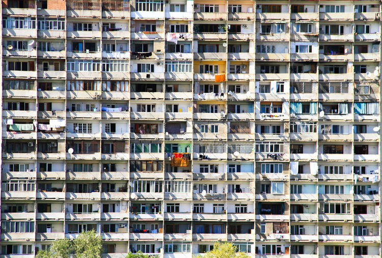 Tbilisi_Soviet_architecture The Graphic City Building Exterior Architecture Built Structure Building Residential District City Full Frame Window Day Apartment Outdoors People Nature Men Balcony Real People In A Row Backgrounds Working Office Building Exterior Skyscraper The Architect - 2019 EyeEm Awards