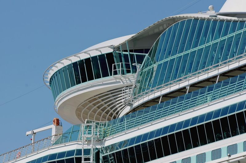 The external steel and glass structure of a cruise ship taken from below.