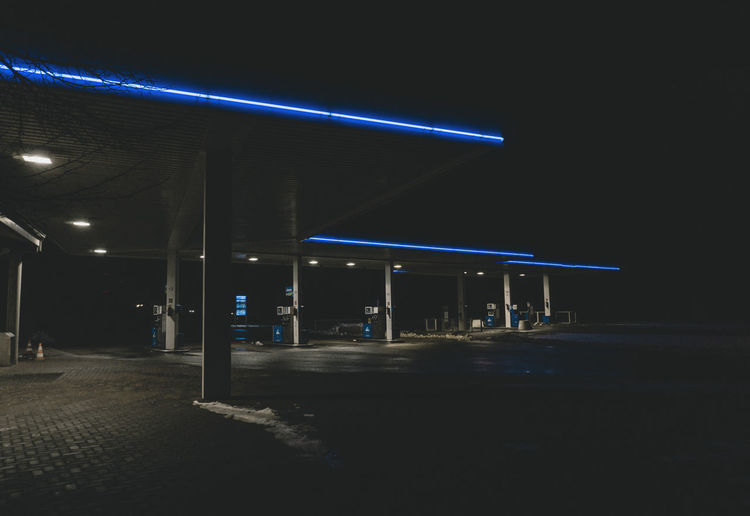 Illuminated empty parking lot at night