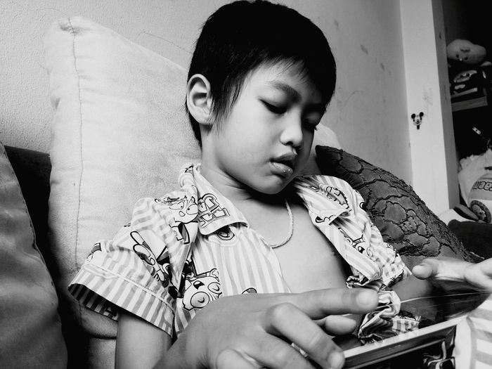Child Using Tablet At Home