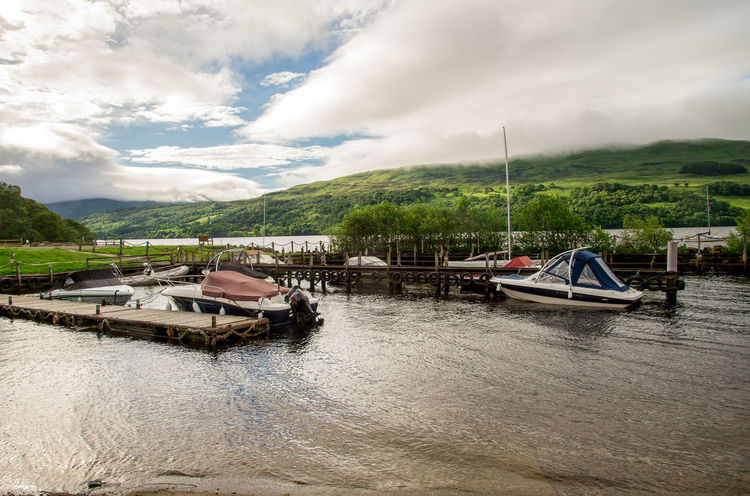 A view of Loch Tay boat station with background highland hills in cloudy weather, central Scotland Boat Station Family Holiday Loch Tay Perthshire Pier Scenic Scotland Trees Boat Cloud - Sky Coast Cruising Fishing Highlands Jetty Killin  Lake View Lakeshore Outdoors Rental Vacation Water Wooden