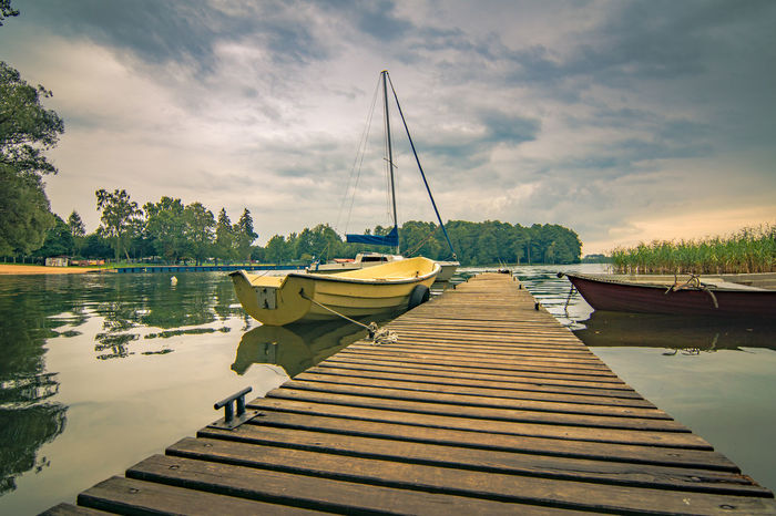 Beauty In Nature Boat Cloud - Sky Day Harbor Jetty Lake Mast Mode Of Transport Moored Nature Nautical Vessel No People Outdoors Reflection Sailboat Scenics Sky Tranquil Scene Tranquility Transportation Tree Water Yacht The Week On EyeEm