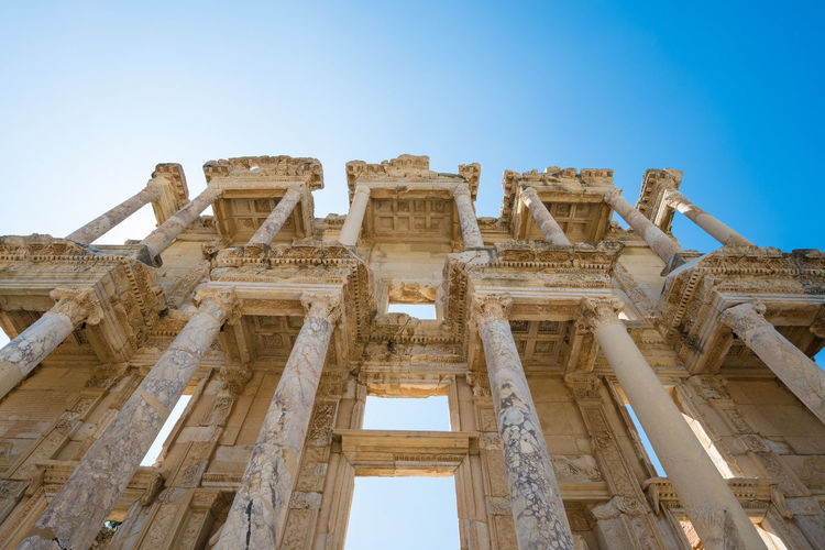 Ruins of the library of Celsus in Ephesus Turkey,. Ephesus contains the ancient largest collection of Roman ruins in the eastern Mediterranean. Ancient Archeology Architectural Architecture ASIA Attraction Building Celsus Classic Columns Detail Ephesus Famous Frontage Gate Heritage History Izmir Landmark Landscape Library Marble Old Ottoman Outdoor People Roman Ruins Selçuk Sights Sightseeing Stone Stories Structure Tourism Tourist Travel Turkey Unesco Unseen Vacation World Architectural Column Outdoors Ruined Built Structure The Past Travel Destinations Ancient Civilization Old Ruin