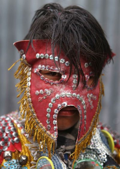 Close-up of man wearing mask during festival