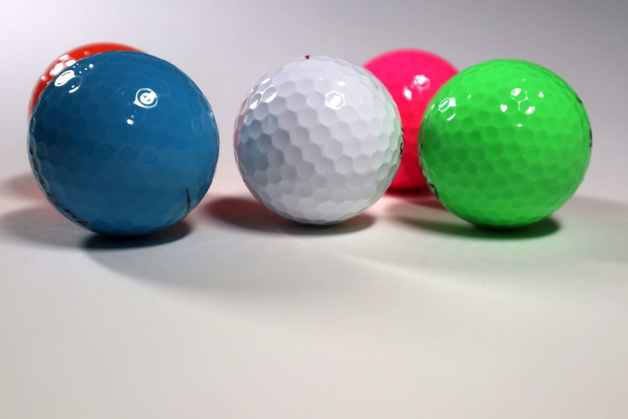 CLOSE-UP OF COLORFUL BALLS ON TABLE