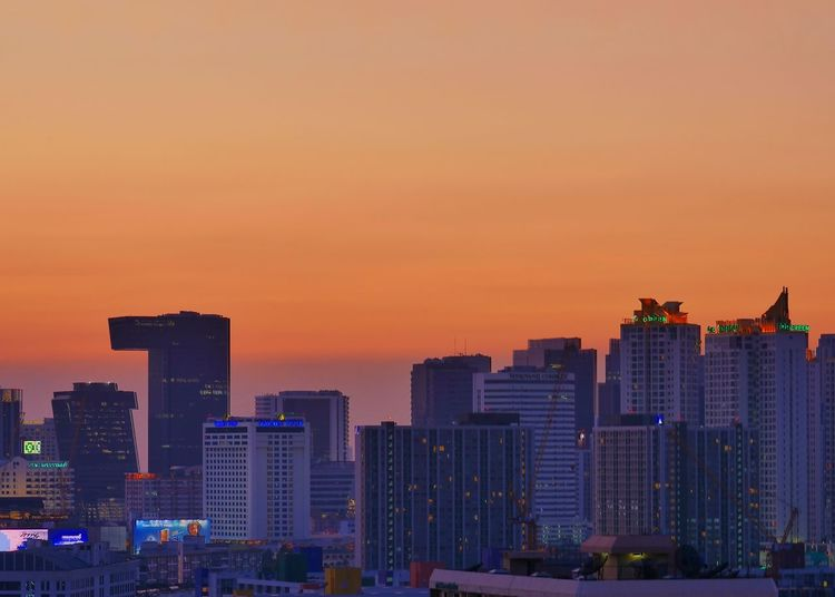 Modern buildings against romantic sky at sunset