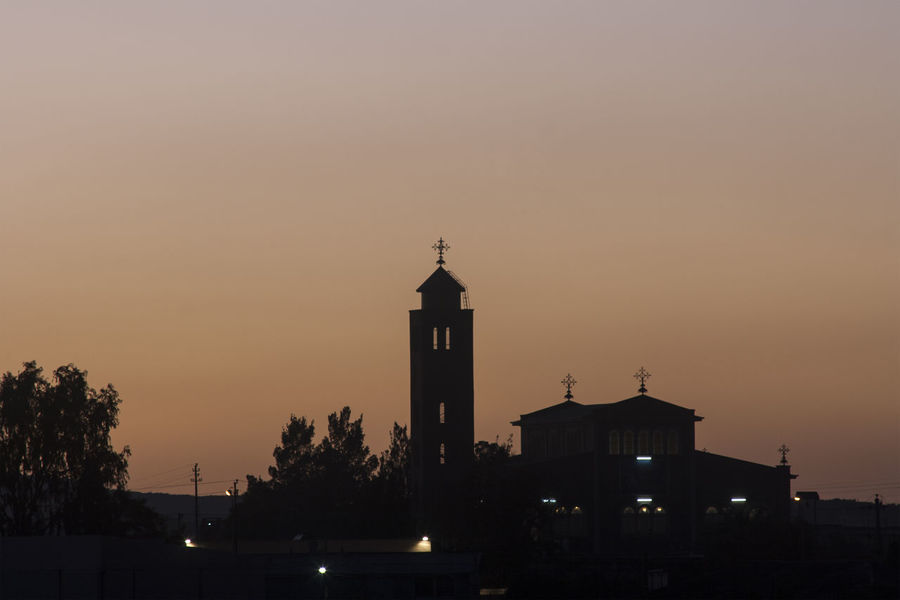 View ower Asmara in the first morning light Church Clear Sky Eritrea North Africa Orange Sky Skyline Architecture Building Exterior Built Structure Capital City City Lights Clear Sky Day No People Outdoors Silhouette Sky Sunrise Sky Sunset Sunset Sky