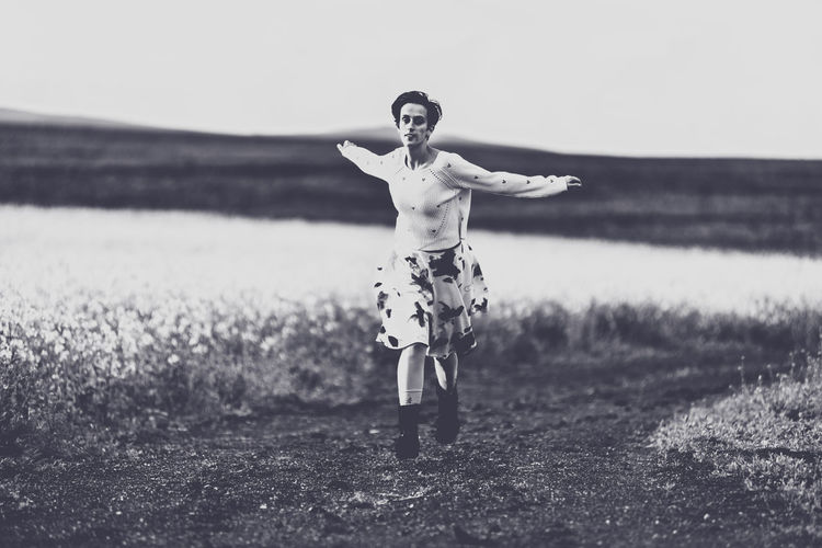 Woman in skirt running on a countryside road. Freedom concept. Black and white, toned, vintage effect Females Free Freedom Nature Running Woman B&w Concept Day Dust Road Film Noir Style Girl Land Leisure Activity Lifestyles Motion Movement Nature One Person Outdoor Outdoors Real People Speed Toned Way