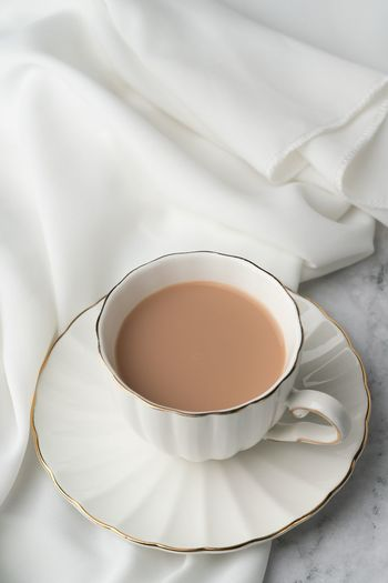 Milky Tea Tea With Milk Milk Tea Food And Drink Cup Drink Mug Indoors  Refreshment Still Life Saucer Coffee Cup Crockery Hot Drink Freshness Food No People Tea - Hot Drink Tea White Color Coffee Close-up Textile