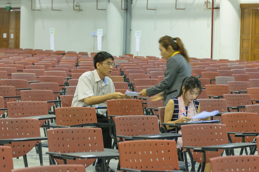 Boys Campus Casual Clothing Chair Childhood Classroom Day Education Elementary Age Girls High School High School Student Indoors  Learning Lecture Hall Lifestyles Real People School Uniform Sitting Standing Student Teenager University University Student Women