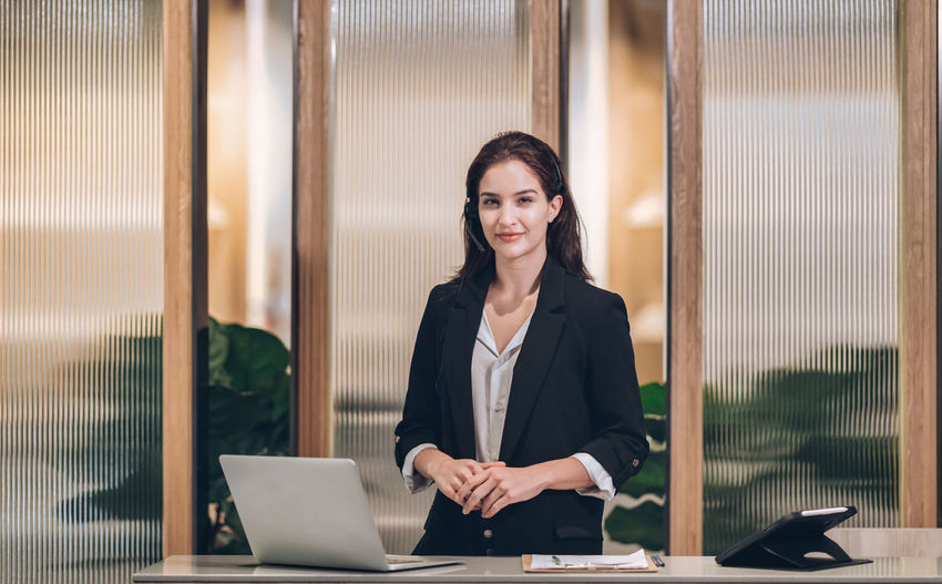Smile receptionist welcome at hotel front desk