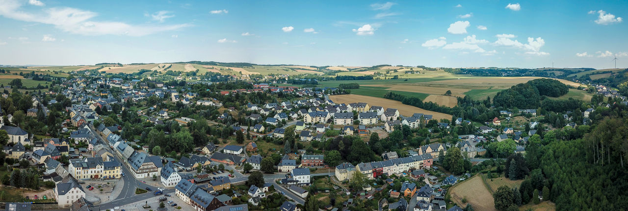 panoramic aerial view of a small town Hartenstein in saxony, germany Hartenstein Aerial View Aerial View Of City Architecture Building Exterior Built Structure City Cityscape Cloud - Sky Drone Footage Dronephotography Environment High Angle View Landscape Nature No People Outdoors Saxony Sky Tree