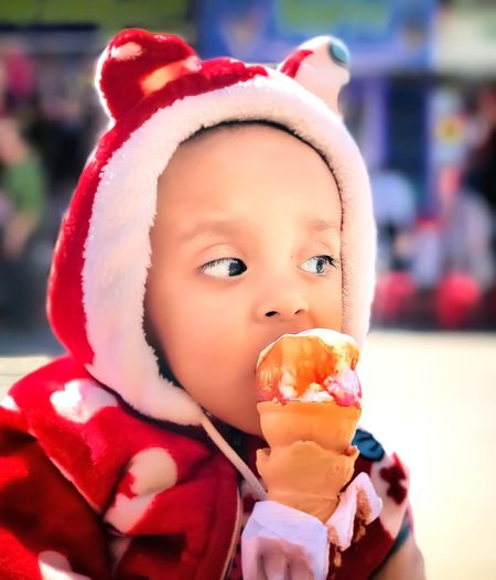 Close-Up Of Baby Boy Eating Ice Cream Cone