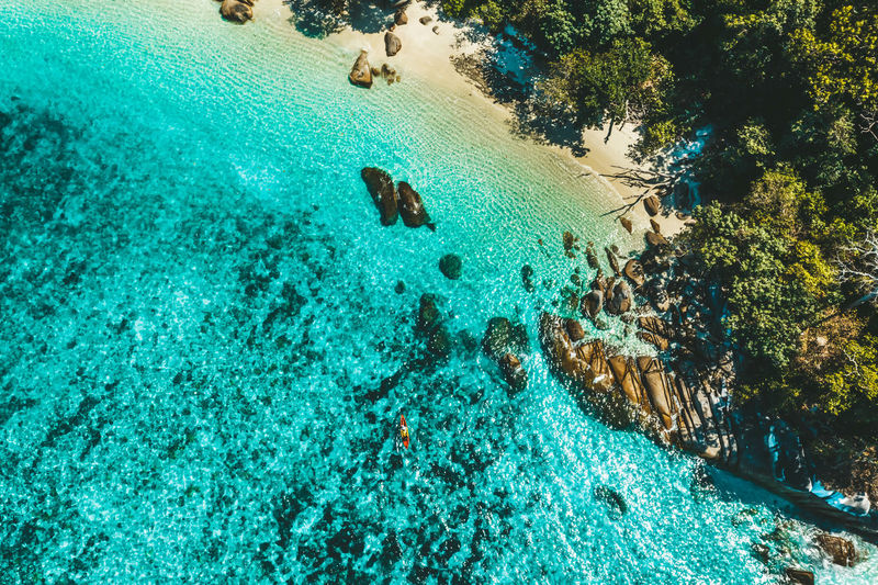 Aerial View of Boulder Island, Myanmar Sea Water Nature Tree Blue Day Outdoors Sea Life Rock Tranquility Land Myanmar Burma Marine Top View Beauty In Nature Transparent Indian Ocean Andaman High Angle View Turquoise Colored Areal View Scenics - Nature Boulder Island Nga Khin Nyo Island