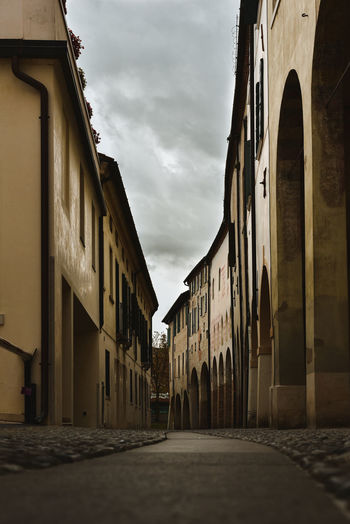 Cobblestone street in Treviso Italy Treviso Italy Cobblestone Cobblestone Streets Architecture Building Exterior Built Structure Building Cloud - Sky Sky City Street Residential District No People Nature The Way Forward Direction Outdoors Dusk Road Town Day Empty Old Alley