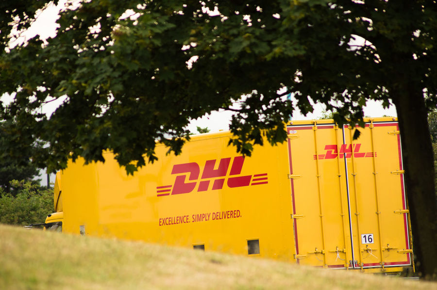 DHL EXCELLENCE. SIMPLY DELIVERED. Day Delivery Delivery Truck Dhl DHL EXCELLENCE. SIMPLY DELIVERED. DHL Express DHLawrence DHLExpressCo Focus On Foreground Grass Heahtrow Heahtrow Dhl Outdoors Transport Transportation Tree United Kingdom VAN Delivery Vanishing Point Yellow