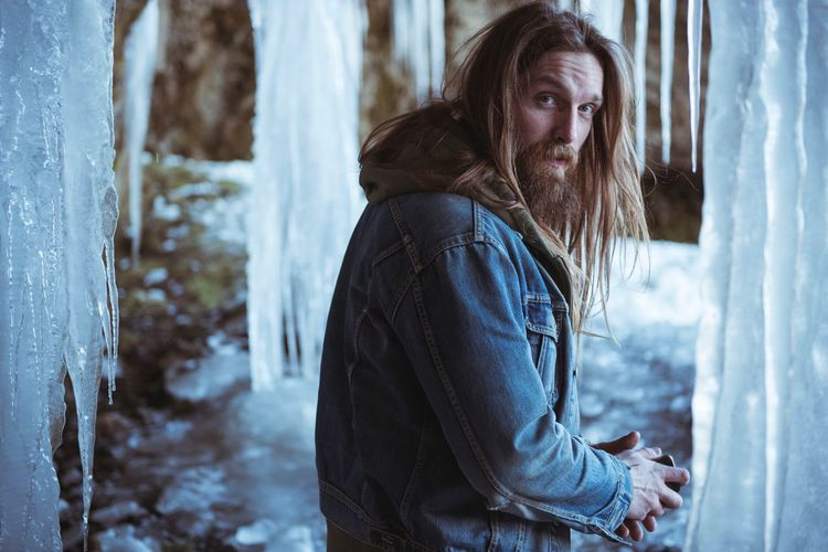 In my element in Iceland Longhair Beard Jeansjacket Denimjeans Denim Viking Cold Temperature Kingofthenorth EyeEm Selects Cold Temperature One Person Outdoors Nature First Eyeem Photo