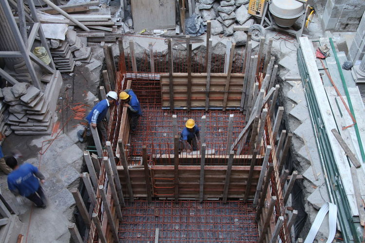 High angle view of construction workers at site