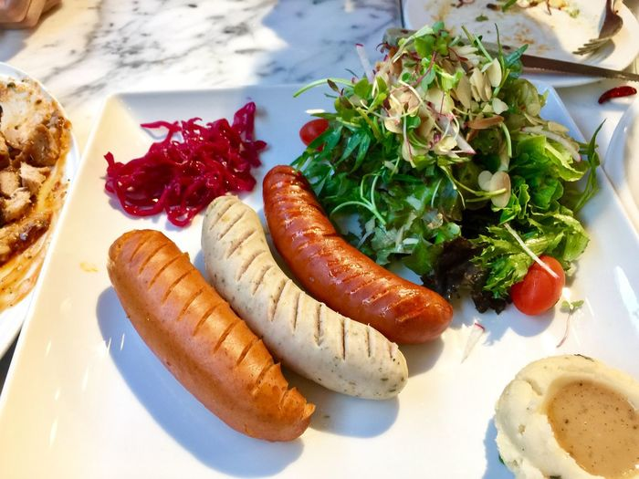 Sausage with salad Food And Drink Food Freshness Ready-to-eat Still Life Vegetable Healthy Eating Indoors  Meat No People Wellbeing Sausage Plate Serving Size High Angle View Table Meal Close-up Bread Fruit